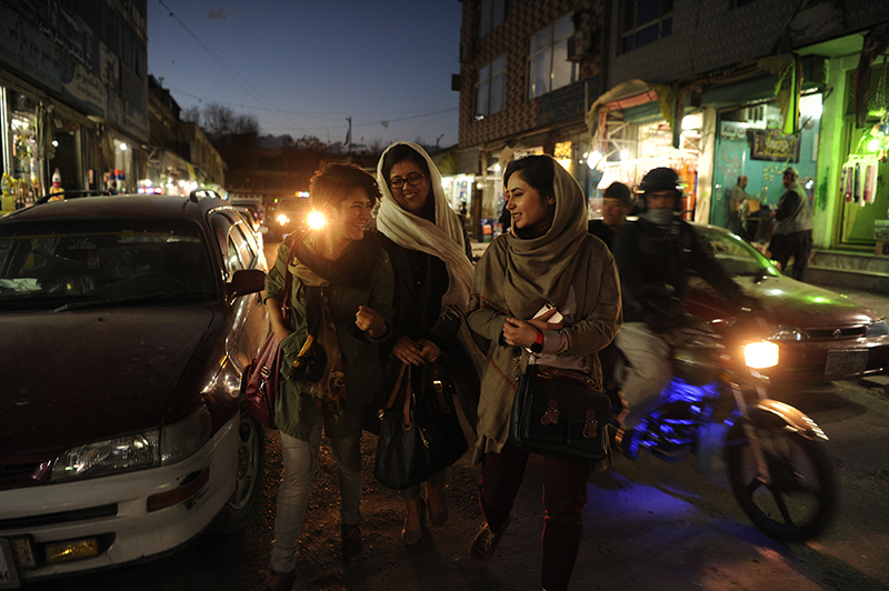 22-year-old Mubareka Sahar Fetrat (left) on her way home after socializing with friends in a café in Kabul, Afghanistan, March 27, 2018. © Farzana Wahidy