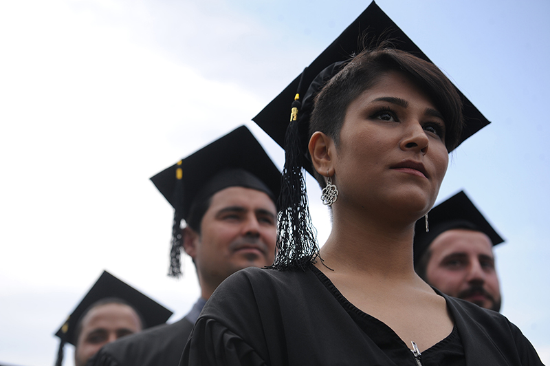 22-year-old Mubareka Sahar Fetrat stands in line as she waits to receive her BBA degree from the American University of Afghanistan during her graduation ceremony in Kabul, Afghanistan, May 11, 2018. Currently she is completing her second MA in War Studies at KCL following her first MA degree in Critical Gender Studies at Central European University and plans to return to Afghanistan after she finishes her education. © Farzana Wahidy